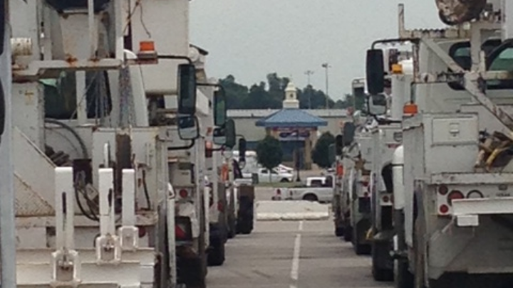 Trucks are lined-up in staging area.