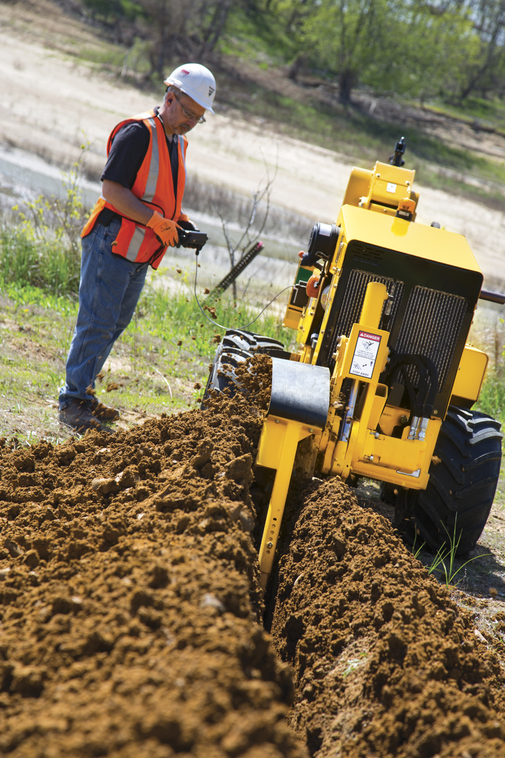 Content Dam Up En Articles 2015 07 Construction Equipment Walk Beside Service Plow With Trencher Leftcolumn Article Thumbnailimage File